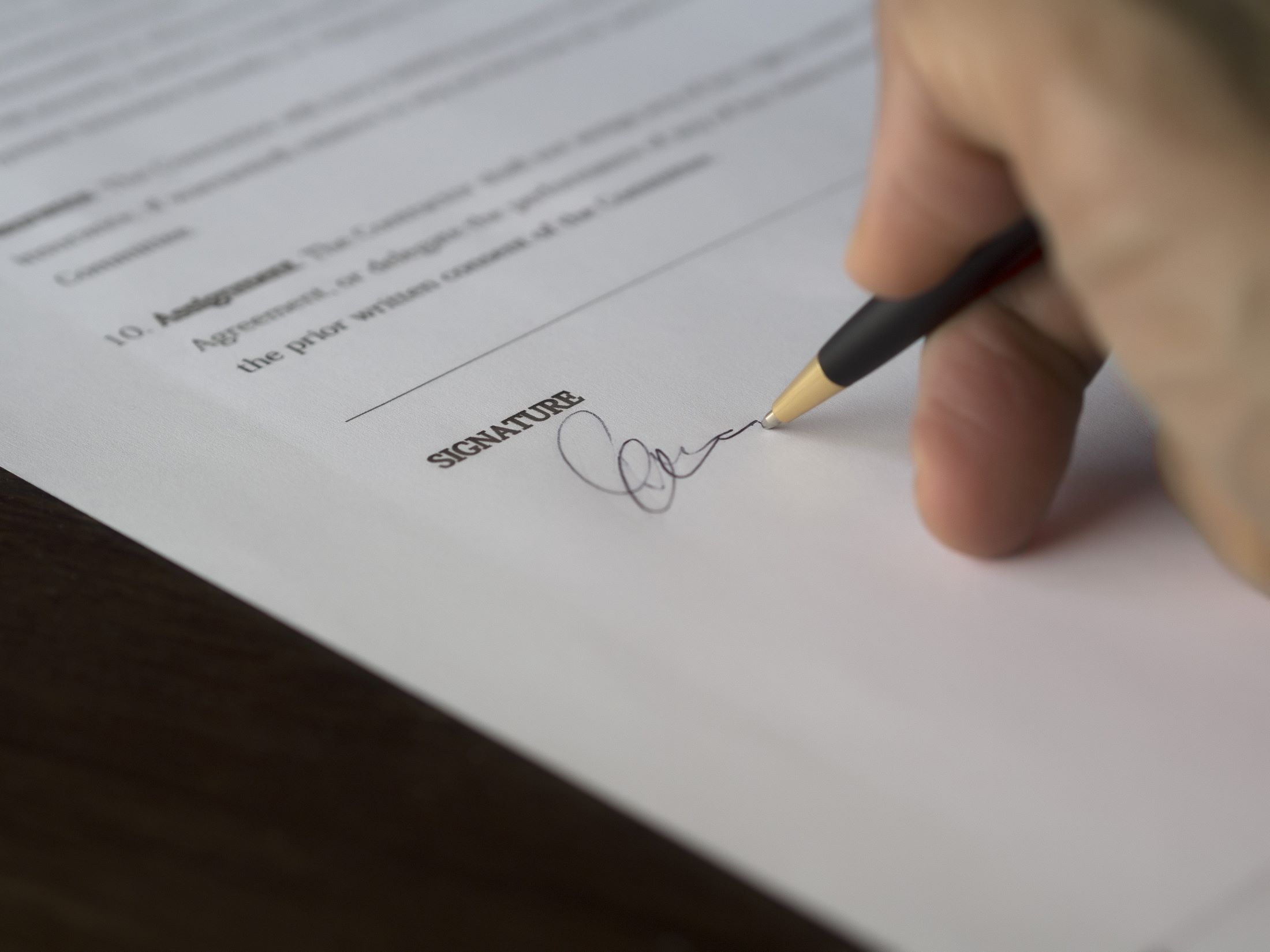 essential documents for estate planning person signing a document