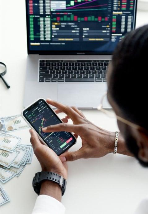 return on principal man on calculator money laptop stock chart
